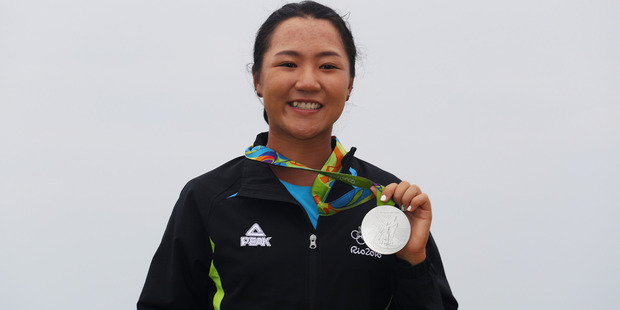 Silver medalist Lydia Ko poses on the podium during the medal ceremony for Women's Golf event in Rio. Photo / Getty Images