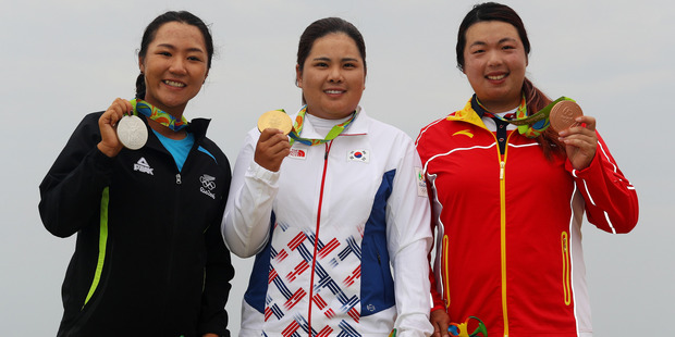 (L-R) Silver medalist, Lydia Ko of New Zealand, gold medalist, Inbee Park of Korea and bronze medalist Shanshan Feng of China pose on the podium. Photo / Getty Images