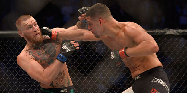 Nate Diaz punches Conor McGregor in their welterweight bout during the UFC 202 event. Photo / Getty Images