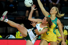 Erin Burger of South Africa takes a pass under pressure from Stephanie Wood of Australia. Photo / photosport.nz