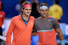 Rafael Nadal and Roger Federer pose at the net before their semifinal at the Australian Open. Photo / AP