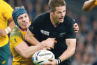 Richie McCaw of New Zealand is tackled by David Pocock of Australia during the 2015 Rugby World Cup Final. Photo / Brett Phibbs.