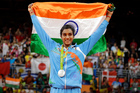 India's V. Sindhu Pusarla wears her silver medal during the medal ceremony for women's badminton singles. Photo / AP