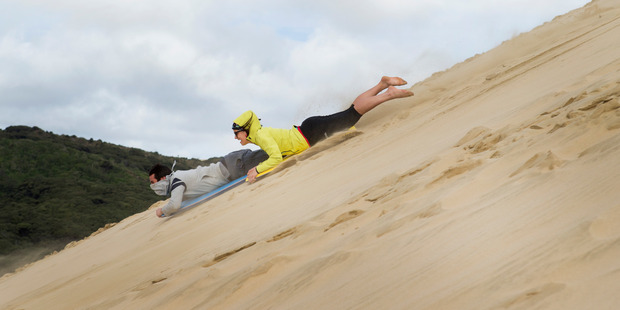 Take dad for a slide down the giant Te Paki sand dunes in the Far North. Photo / Mark Mitchell