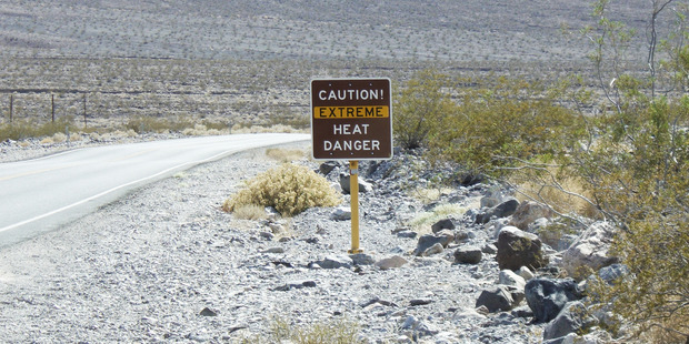 A sign in Death Valley warns visitors of temperatures that can climb above 49C in summer. Photo / Fosco Lucarelli, Flickr.
