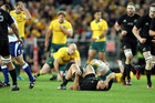 Codie Taylor was injured as the All Blacks romped to victory over Australia. Photo / photosport.nz