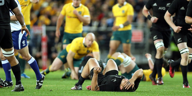 Loading Codie Taylor was injured as the All Blacks romped to victory over Australia. Photo / photosport.nz