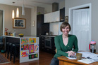 Laura Borrowdale in her kitchen, which doubles as the base for her Aotearotica journal. Photo / Simon Baker