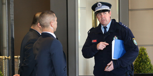 A policeman speaks to hotel security outside the Intercontinental Hotel, where the All Blacks are staying ahead of their test. Photo / File