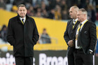 All Blacks coach Steve Hansen, left, with Grant Fox and one of the All Blacks' security detail before the first Bledisloe test match in Sydney on Saturday night. Photo / Brett Phibbs