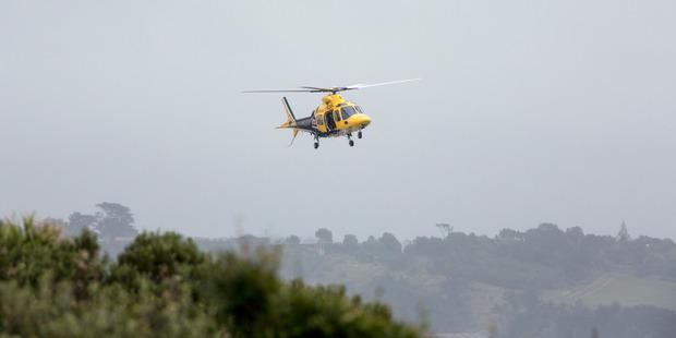 A Taranaki Rescue Helicopter takes part in the search for the boatie missing off the Taranaki coast. Photo / Russ Dixon