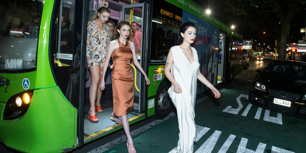 Models step off a bus on Karangahape Rd wearing the local fashion label Miss Crabb before appearing at a fashion week show. Photo / Jason Oxenham