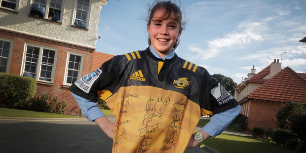 SUPER SHIRT: Kaia Potaka Osborne wearing the signed Hurricanes shirt that she hopes will raise much-needed funds for a good cause.