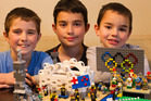 Jacob Orsler, Sam Orsler, and Isaac Orsler. The young brothers decided they would turn their favourite Olympic moments into lego creations. Photo / Alan Gibson