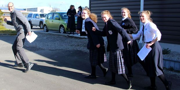Drama teacher Darin Ramsay being chased by Courtney Hatcher, Payton Agent, Rebekah Davis and Tyne Payne.