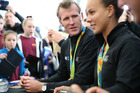 Gold medalist Mahe Drysdale signing autographs with fellow gold medalist Lisa Carrington. Photo / Mike Scott
