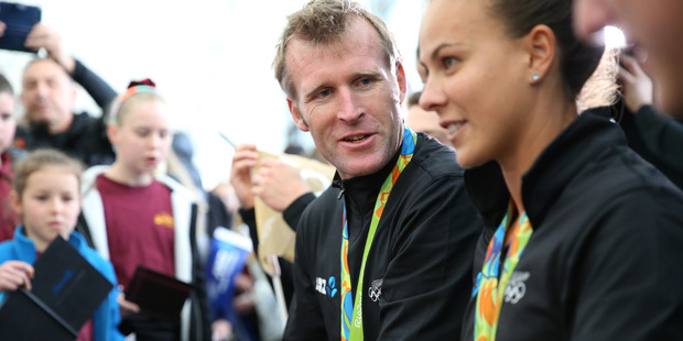 Loading Gold medalist Mahe Drysdale signing autographs with fellow gold medalist Lisa Carrington. Photo / Mike Scott
