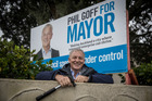 Phil Goff erects an election hoarding at a Remuera house formerly owned by John Banks. 25 August 2016 NZ Herald photograph by Michael Craig