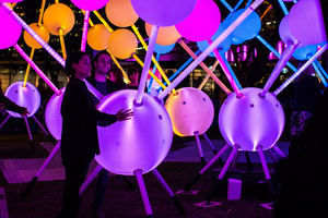 Visitors to Aotea Square are encouraged to touch the Affinity light sculpture.  Photo / supplied