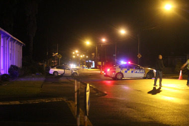 Scene on Kamo Rd, Whangarei, last night after police were shot at following a chase. Photo / Jonty Hare