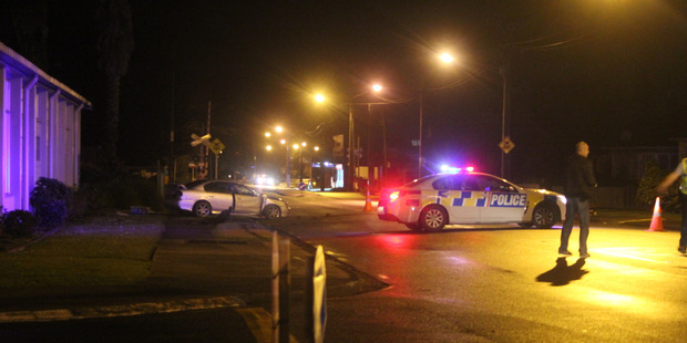 Scene on Kamo Rd, Whangarei, last night after police were shot at following a chase Photo / Jonty Hare