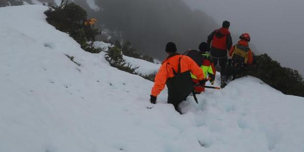The recovery team at work off the Routeburn Track. Photo / Police