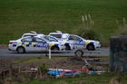 Police vehicles in Kaiwaka where there is a search taking place for an armed man. Photo / Jason Oxenham