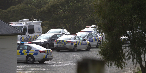 Police vehicles in Kaiwaka behind the Three Furlongs Bar and Grill where there is a search taking place for a gunman. Photo / Jason Oxenham