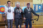 Lionel Treweek, Sue Laugesen and Rob McMillan with their medals from the NZ Nationals in Palmerston North last weekend.