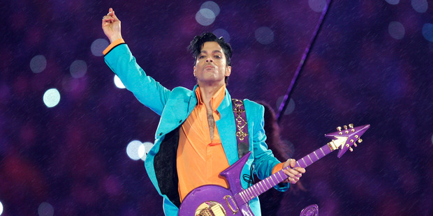 Prince performing with his signature guitar. Photo / AP