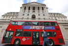 A London bus passes the Bank of England in London. Photo / AP