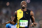 Jamaica's Usain Bolt celebrates as he crosses the line to win gold in the 2016 Olympics men's 100-metre final. Photo / AP