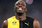 Jamaica's Usain Bolt celebrates as he crosses the line to win gold in the men's 100-meter final during the athletics competitions during Summer Olympics. Photo / AP