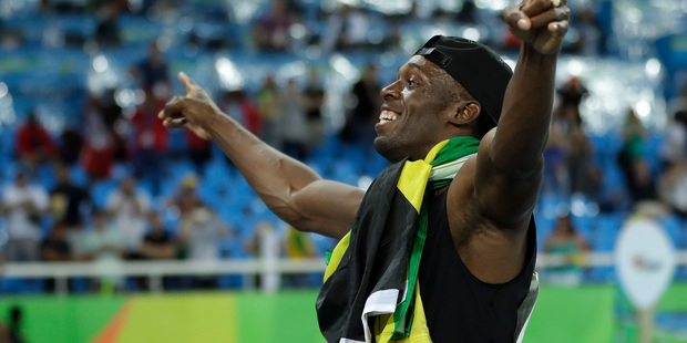 Jamaica's Usain Bolt celebrates winning gold in the men's 4 x 100-meter relay final, during the athletics competitions of the 2016 Summer Olympics. Photo / AP.