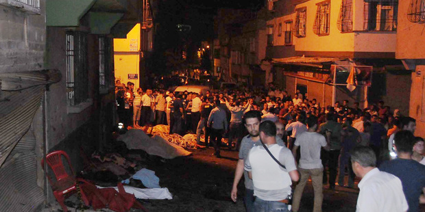 People gather after an explosion in Gaziantep, southeastern Turkey. Photo / AP