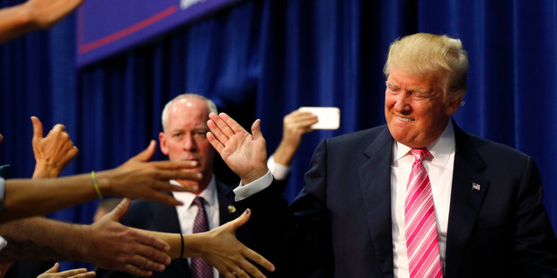 Trump's shifts appear aimed at shoring up support among white GOP moderates. Photo / AP