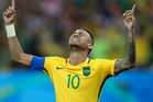 Brazil's Neymar weeps as he kneels down to celebrate after scoring the decisive penalty kick. Photo / AP