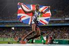 Britain's Mo Farah celebrates winning the gold medal in the men's 5000-metre final. Photo / AP