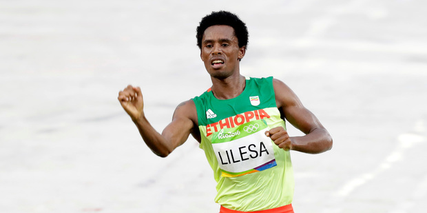Silver medalist Feyisa Lilesa, of Ethiopia, celebrates after crossing the finish line during the men's marathon. Photo / AP