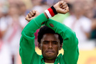 Feyisa Lilesa crossed his arms above his head in an