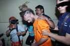 Indonesian police officers escort murder suspect David Taylor to an investigator's room at a local police station in Bali. Photo / AP