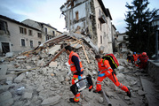 Rescuers search a crumbled building in Arcuata del Tronto, central Italy, where a 6.1 earthquake struck. Photo / AP
