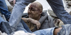 A man is pulled out of the rubble following an earthquake in Amatrice, Italy. Photo / AP