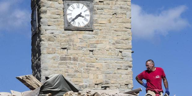 The clock of the Bell Tower of the Italian village of Amatrice is stopped at the time when an earthquake struck central Italy. Photo / AP