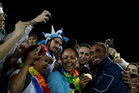 Fiji's Osea Kolinisau, right, poses with supporters after winning the men's rugby sevens gold. Photo / AP