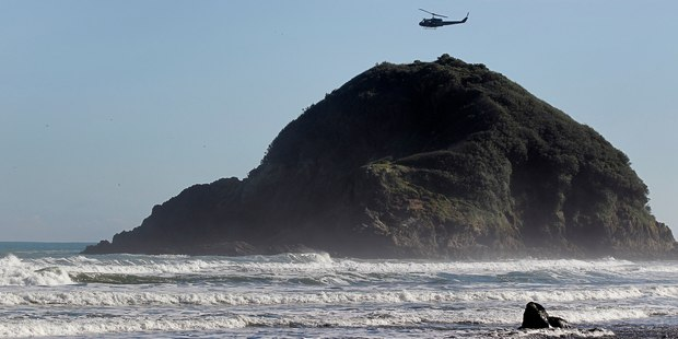 A rescue helicopter has joined police and the Coastguard to search for the missing person near Paritutu Rock. Photo / File