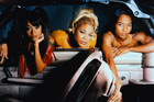 TLC, in their younger years. Tionne Watkins (centre) and Rozonda Thomas (right) will perform in NZ several years after their third member Lisa Lopes (left) died. Photo/Jack Chuck/CORBIS OUTLINE