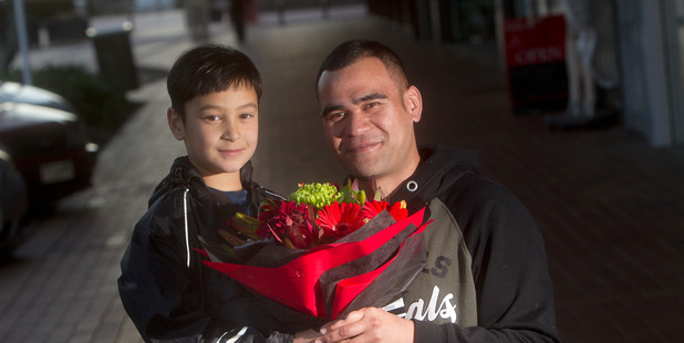 Cameron Bidois thanked Ihaia Herewini with flowers for saving him from a ferocious dog attack. PHOTO/BEN FRASER