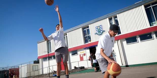 Otumoetai College students can buy healthy food from the canteen. The principal says 3/4 of students do sport. Manaaki Mason-Lowe (left), and Kennedy Singh, play basketball. Photo/Andrew Warner