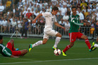 All Whites midfielder Marco Rojas, in action against Mexico in 2013, is returning to the A-League. Photo / NZ Herald.